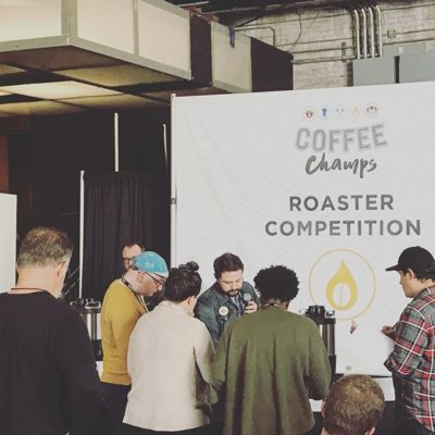 Volunteering at #USCoffeeChamps #NewOrlreans and helping the amazing competitors has been an awesome experience! Here's Paul helping to time the super talented Benjamin from @rockfordroastingco during the #roastercompetition. 🙌🏽