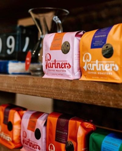 Same great crew, same great coffee, beautifully branded @partnerscoffee #newlook #specialtycoffeeroaster #coffeepackaging #customcoffeebags 📷: @crowncreative